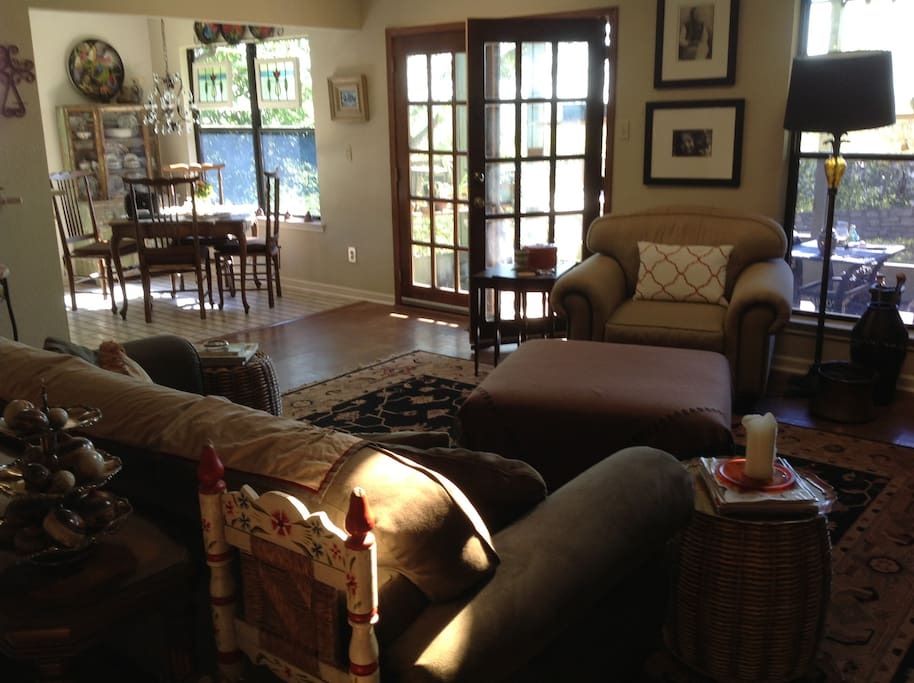 Overview of kitchen, living room and door to screened in porch
