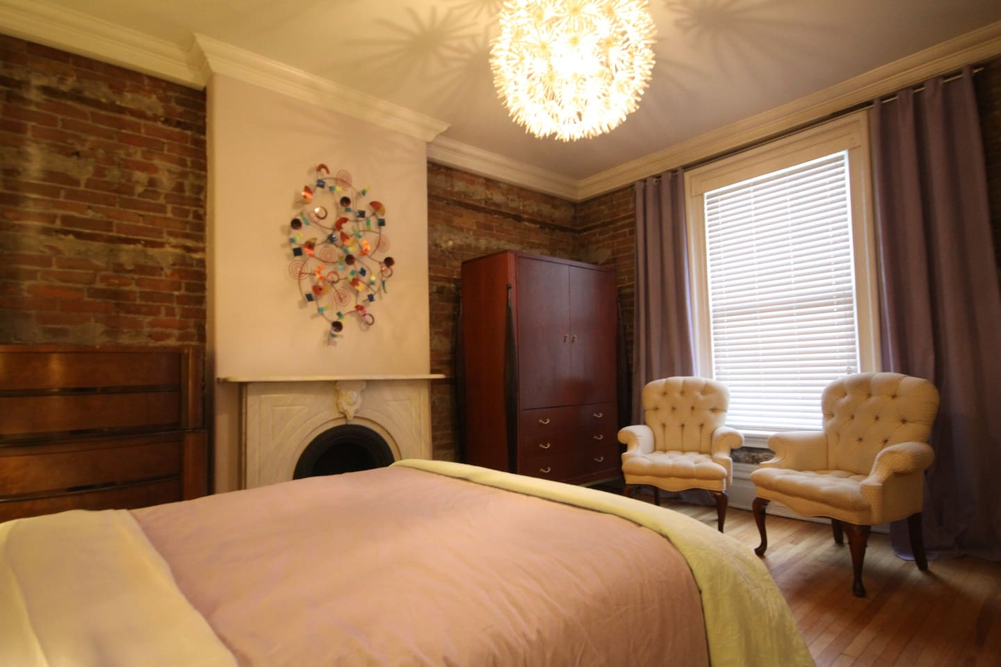 Bedroom #1 of 3 queen bedrooms in this 1871 heritage mansion converted into condos.