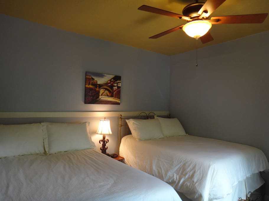 The second bedroom also has two double beds. All rooms have new ceiling fans and air conditioners.
