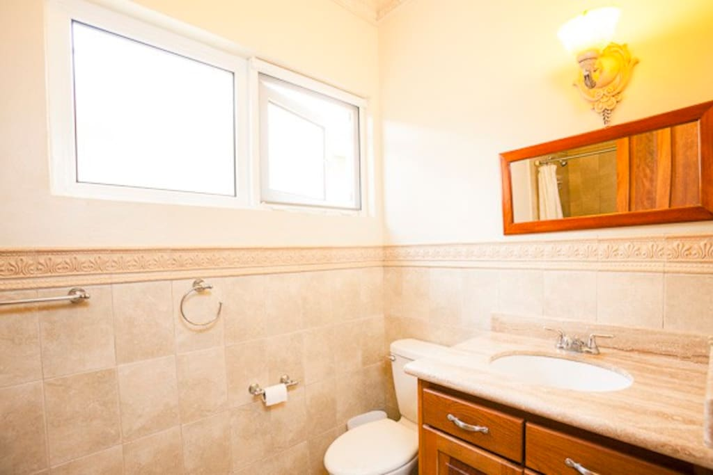 Beautifully tiled bathroom with large shower