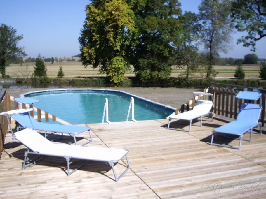 The swimming pool and sundeck, looking out over the lake.