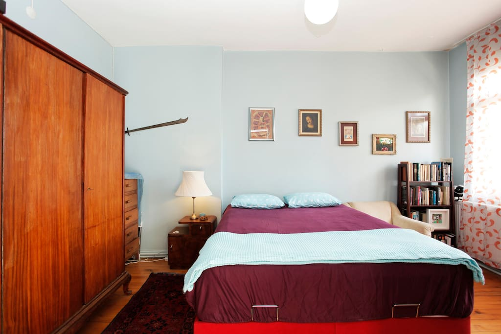 Spacious bedroom with antique wardrobe, bedside table, reading corner.  :-)