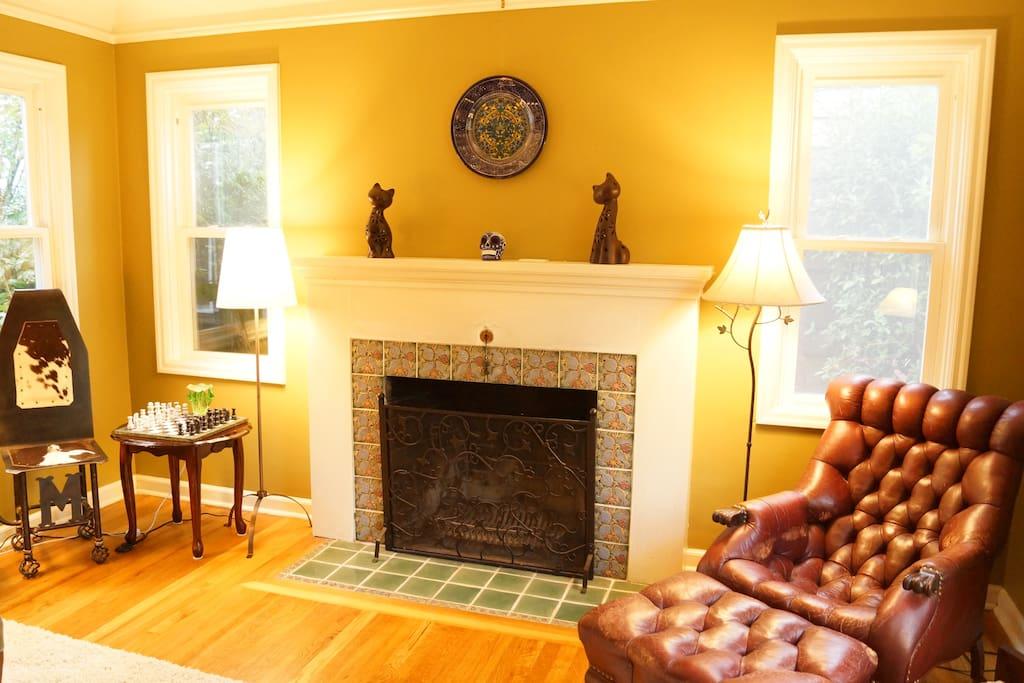 Custom tiling around the fireplace.