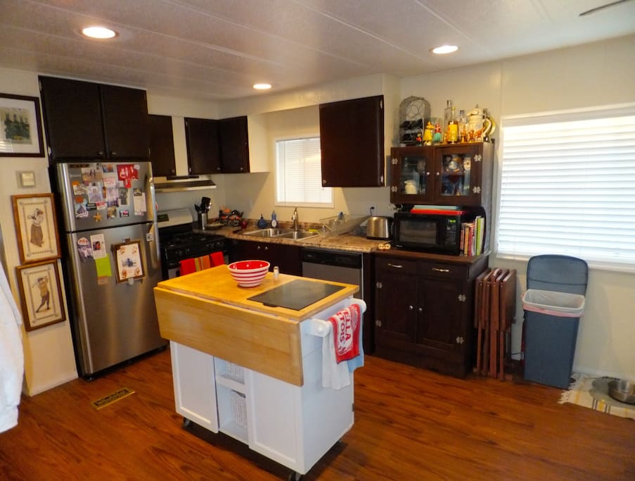 The kitchen has been remodeled with stainless steel appliances