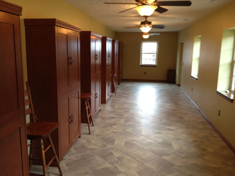 Open Space with  6 Murphy beds stored away