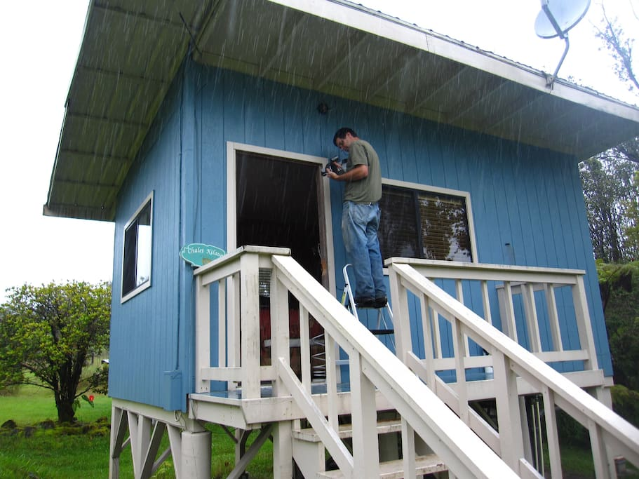 Brian repairing a light on the cottage.  He can fix anything!