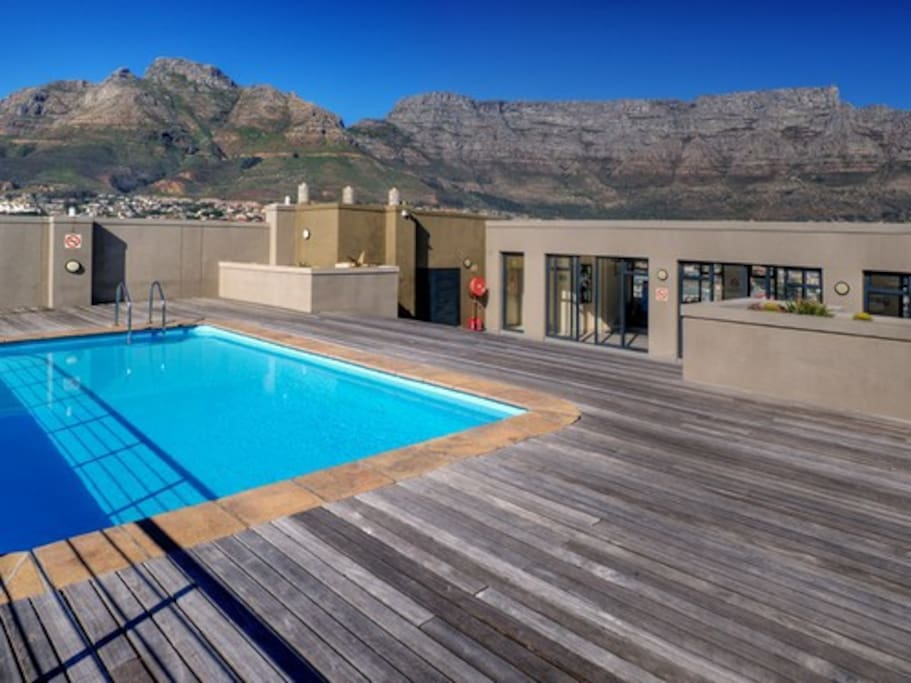 Rooftop pool with the gym and Table Mountain in the background