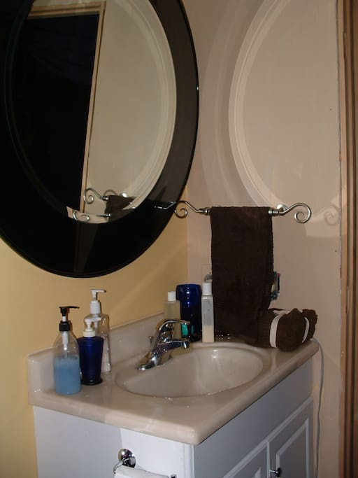 Picture seems bright. But mood lighting actually has glow behind mirror & dimmer in the shower. Brighter light behind you.