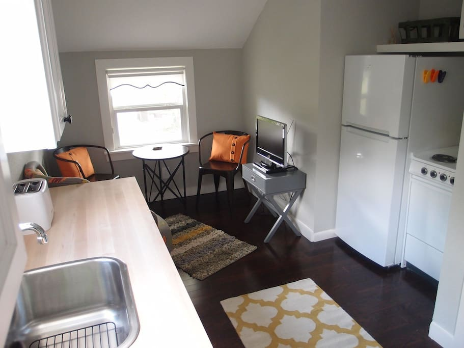 Kitchen includes a refrigerator, oven/stove, and microwave