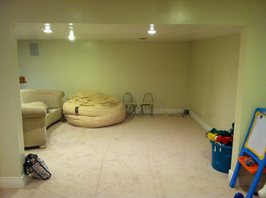 The basement has a large area with a projector for watching movies.