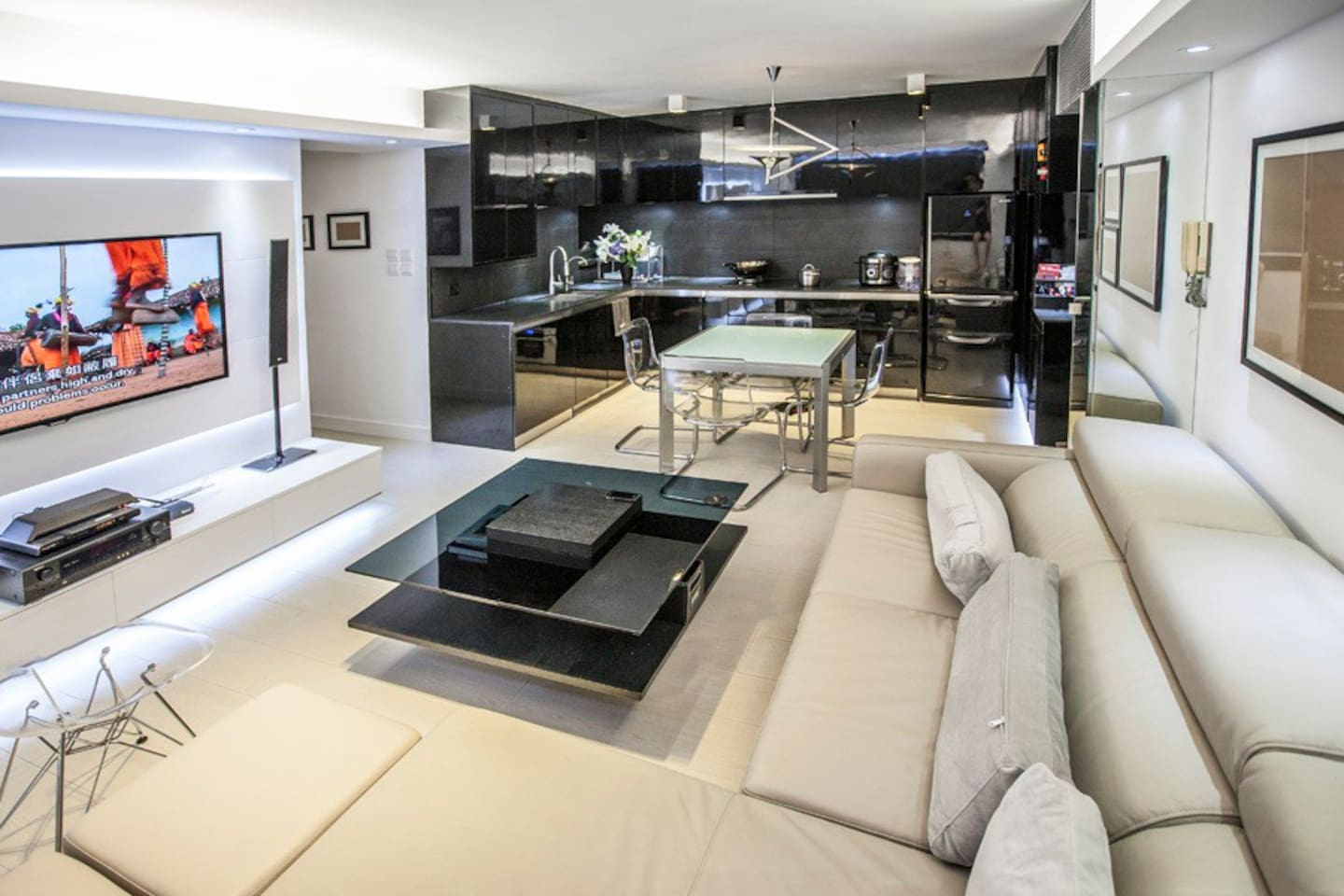 """Open kitchen and living room with 57"""" LED TV"""
