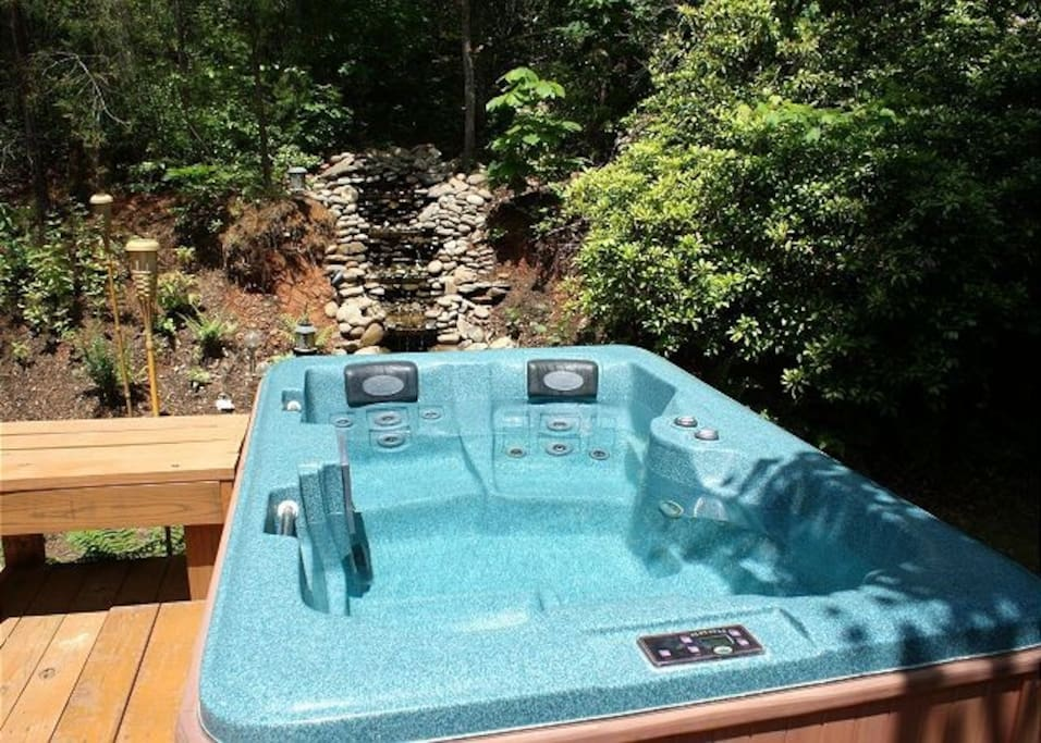 Nice Hot Tub with River Rock Water Feature