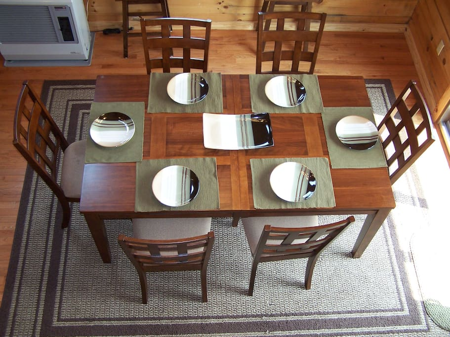 Kitchen table sits 8, there are 2 stools as well.