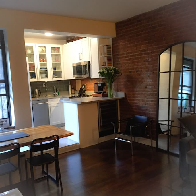 Brand new kitchen attached to living room and access to backyard