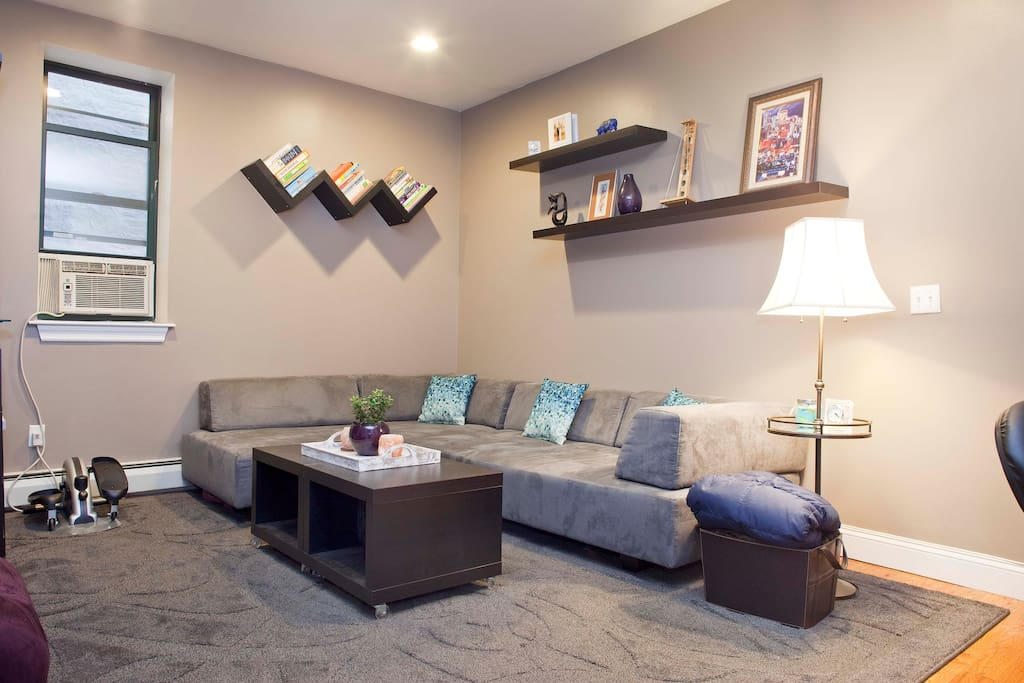 The coffee table is two pieces and they are on casters so that you can pull them closer to you if needed, or push them out of the way to exercise!