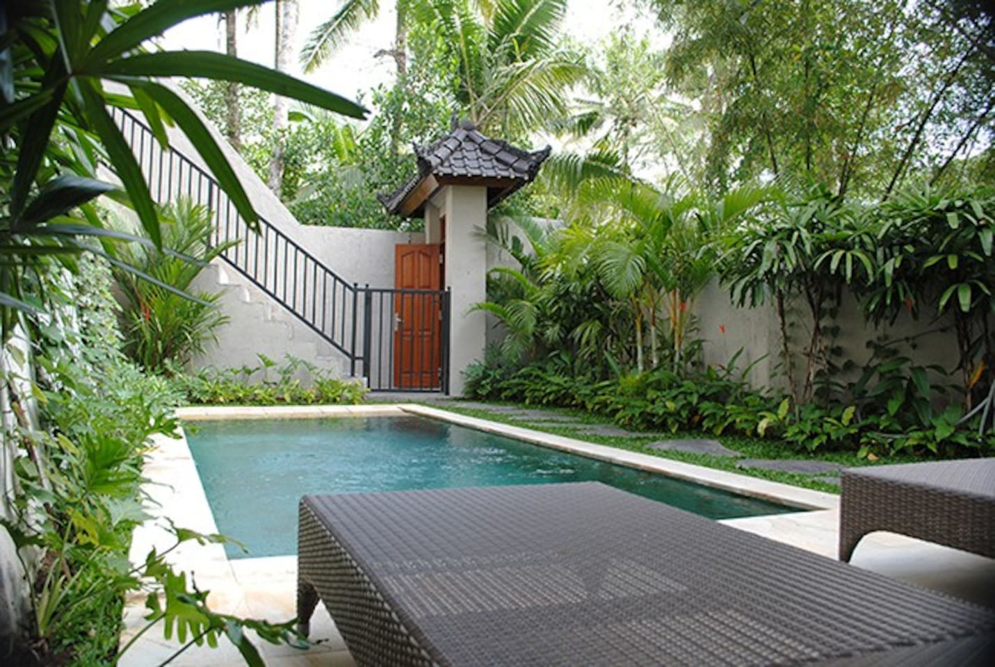 The swimming is fenced and on a terrace of its own.