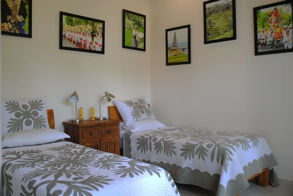 Second bedroom with 2 single beds that come together as a king.