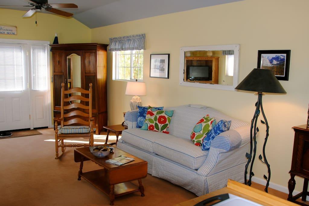 Main room shows door way to bedroom and bath.