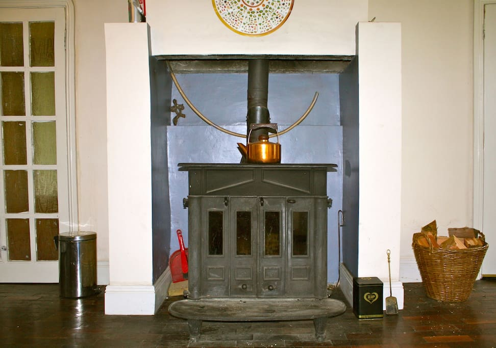 Wood-burning stove in kitchen - dining area