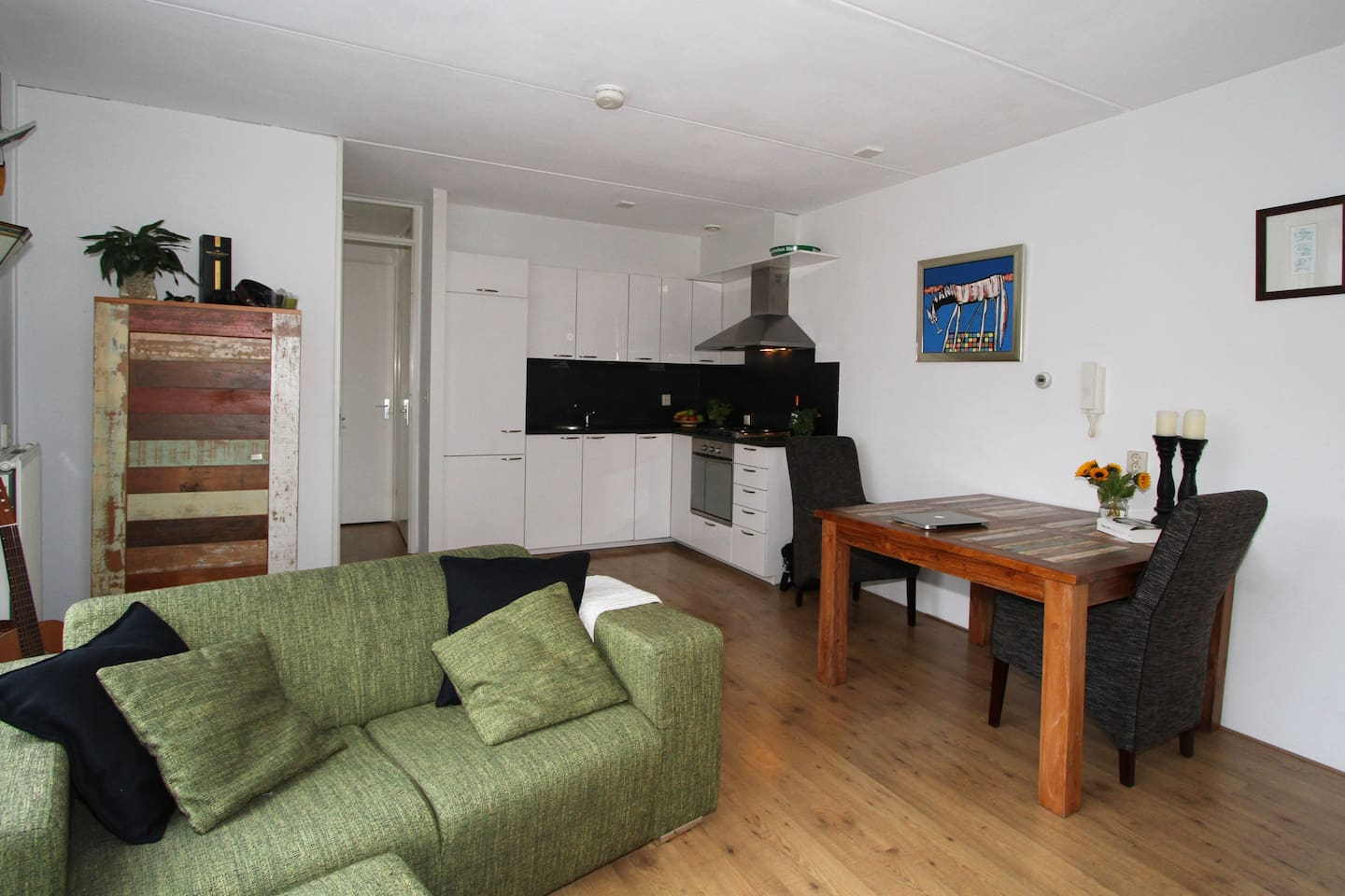 Fully furnished and cozy living room with an open kitchen