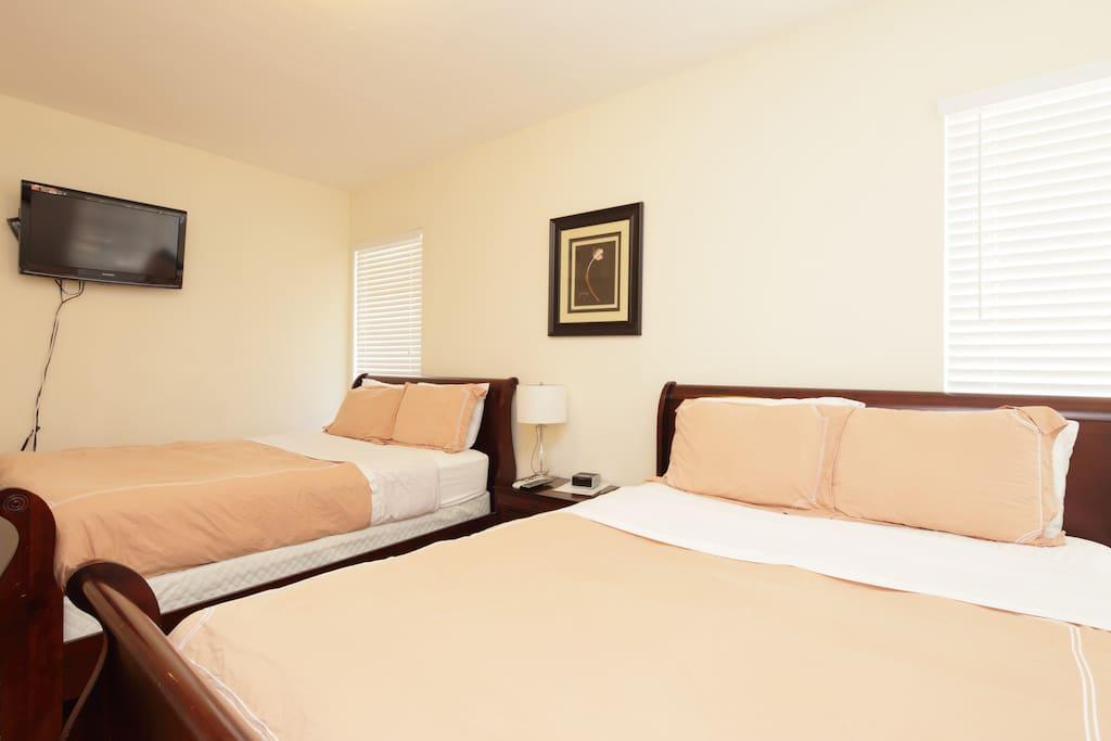 2 Queen beds in each bedroom with flat screen TV
