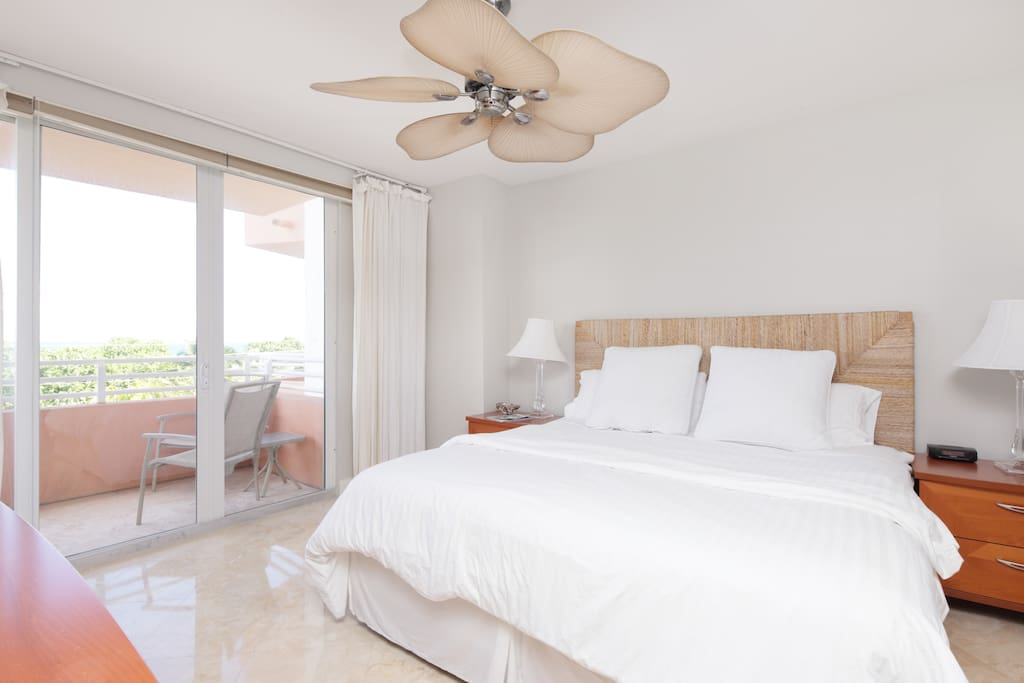 Master Bedroom with King bed and balcony with ocean view