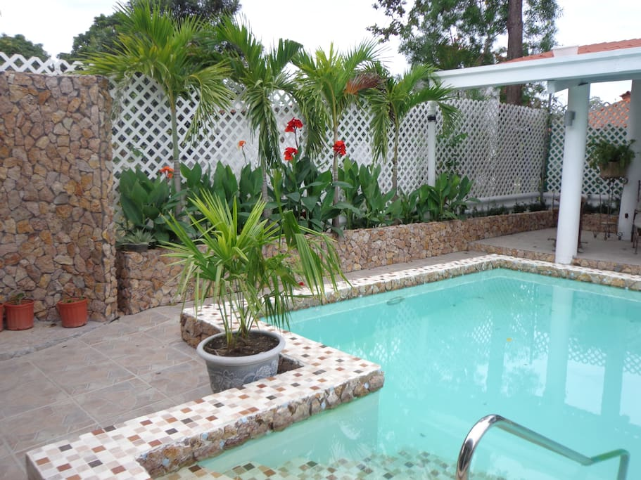 Exotic tropical gardens and outdoor shower