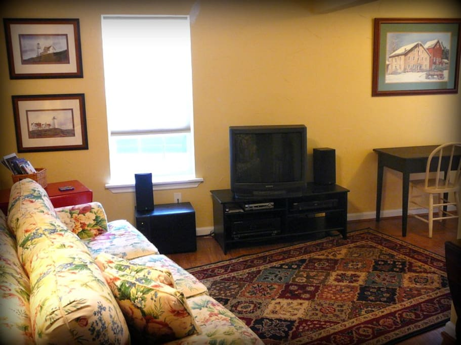 Living Area with a comfortable couch, desk/chair, AT&T UVerse TV, and stereo system