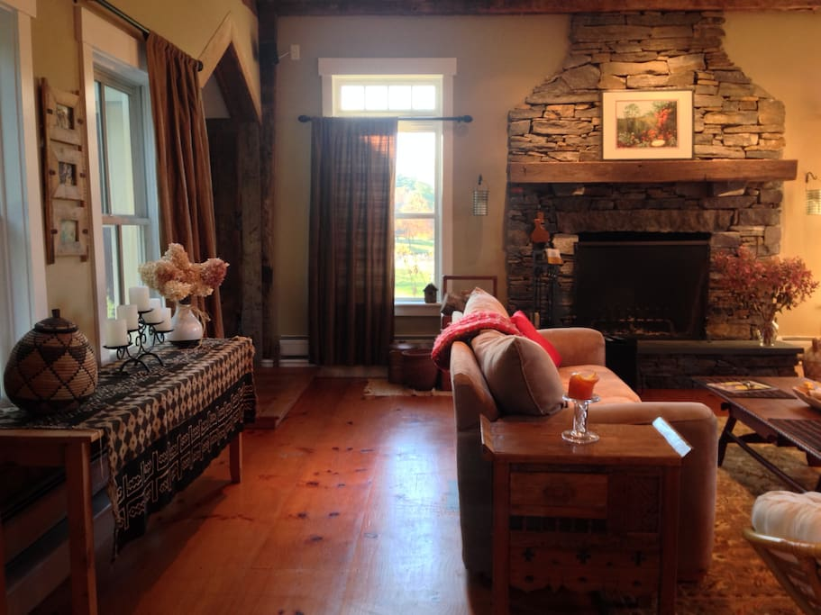 Great Room with large stone fireplace and flat screen Smart TV and ping pong table