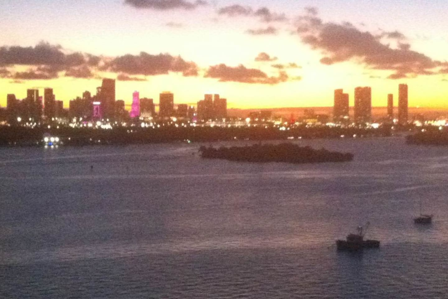 The apartment's amazing sunset view over looking the bay and downtown Miami