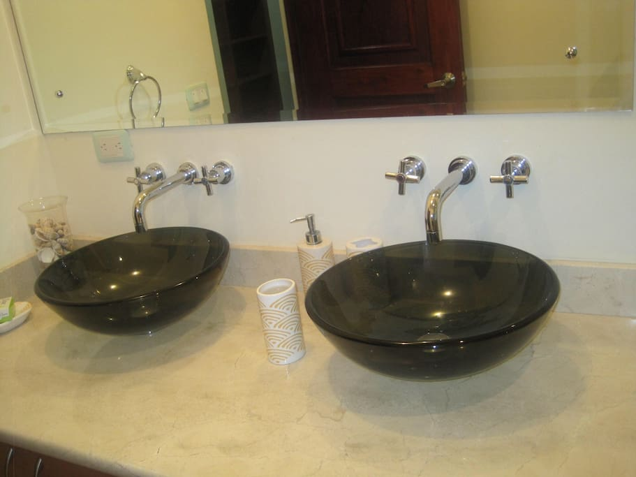 Designer sinks in the guest bathroom