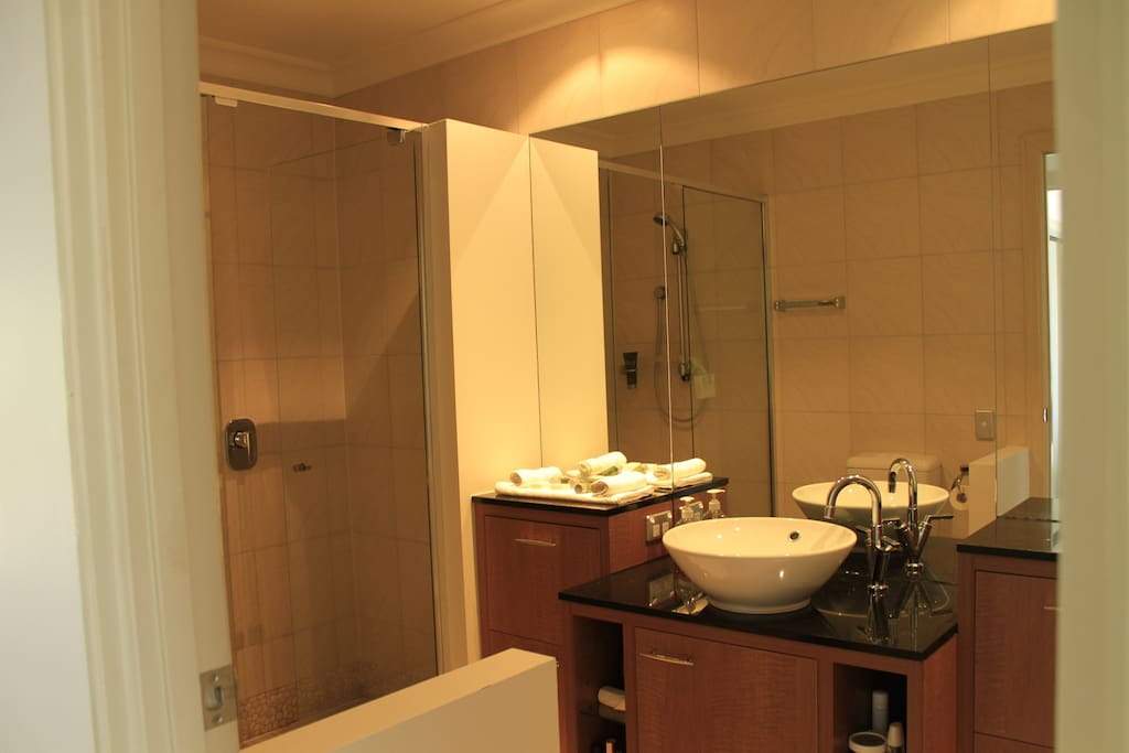 Bathroom with shower, bath tub and toilet