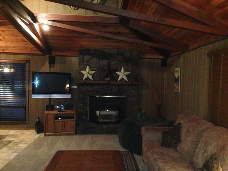 Cozy living room with flat screen tv, gas fireplace, new carpet and flooring throughout