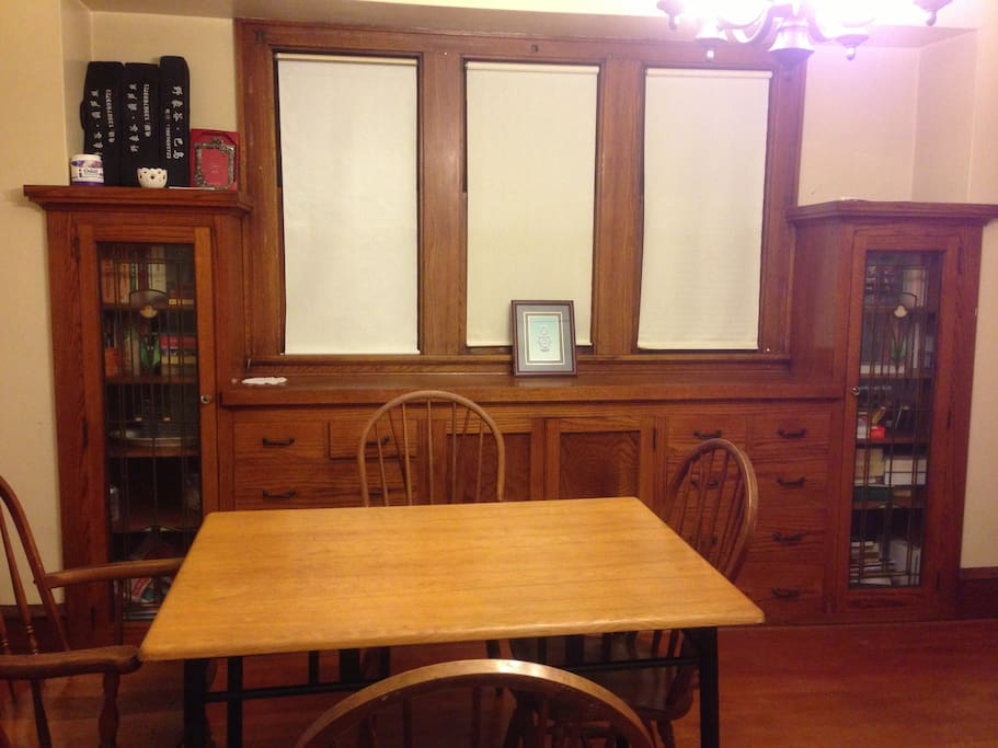 Dinning room with dinning table and hardwood wall cabinet