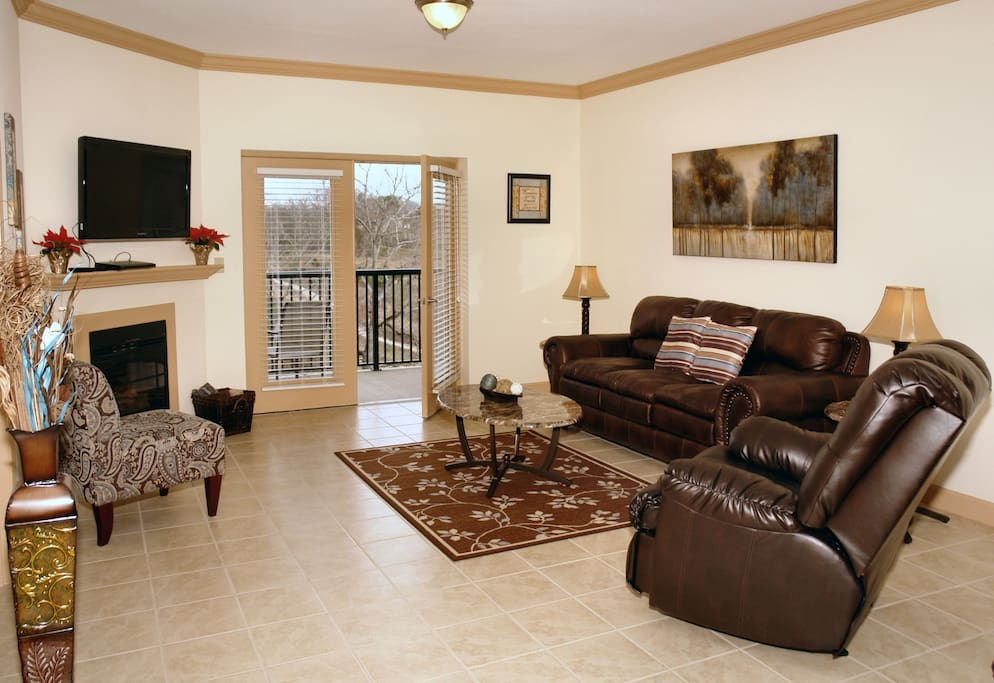 Spacious living room with fireplace and flat screen tv