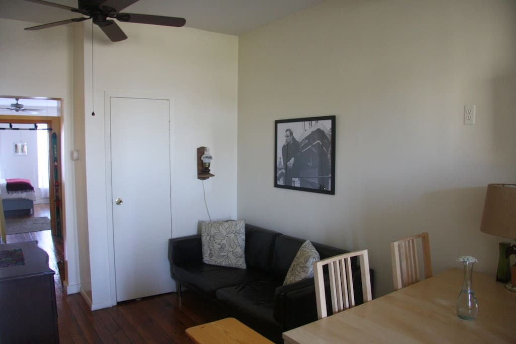 The living room is comfortable, and includes a dining nook.