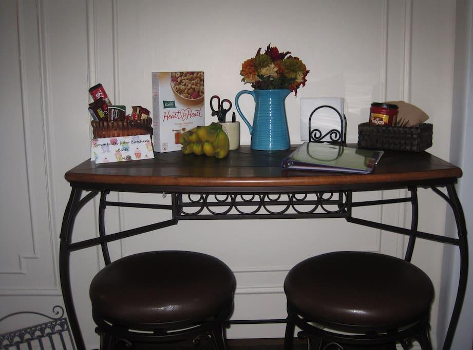 Closeup of Kitchenette (includes stove/oven, full-sized fridge, toaster, blender, mini crock pot, teapot, and coffee maker.