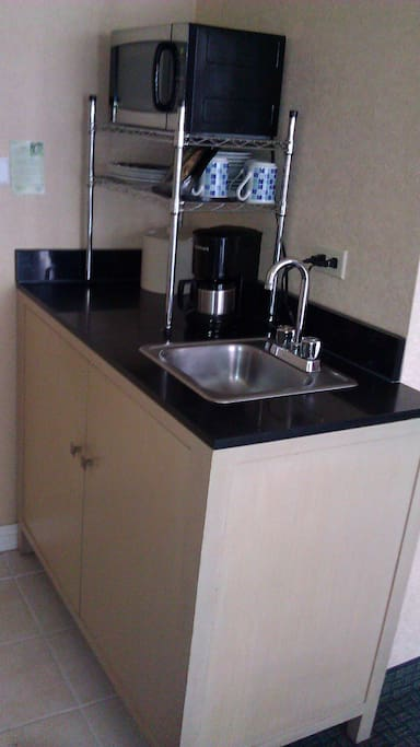 Wet Bar sink with micro wave and coffee maker.