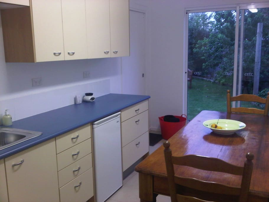 Kitchenette overlooks lovely leafy gardent of fruit trees and vege patch