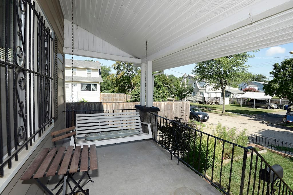 Our porch swing, you are welcome to use it. You can also see there is a lot of free street parking.