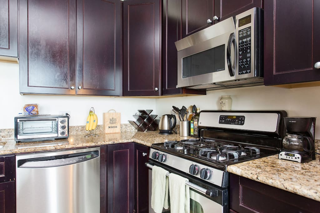 All new appliances, all pots pans, cooking accoutrements and kitchen needs.