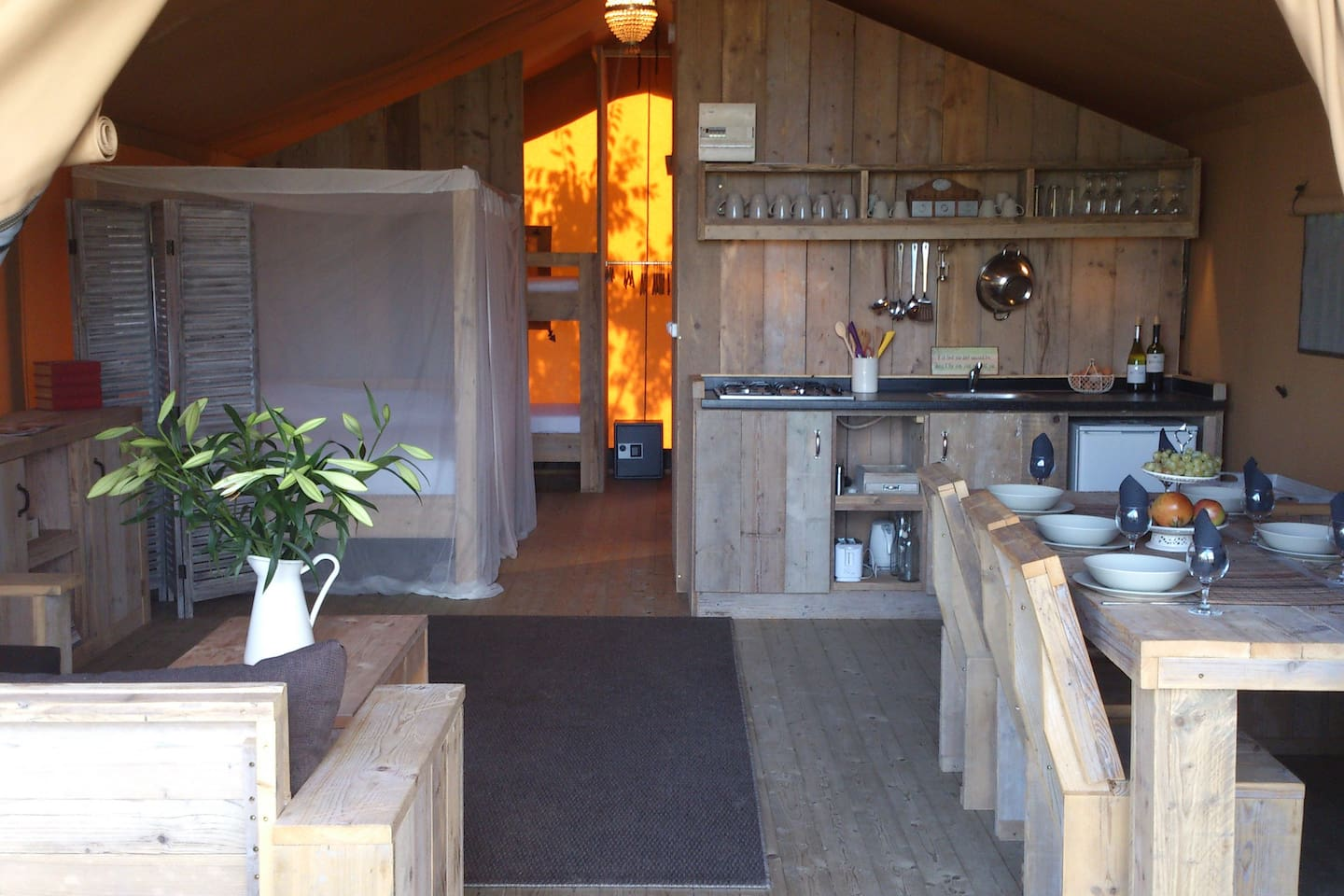 The large living space inside the tent, fitted with natural Dutch wood furniture.