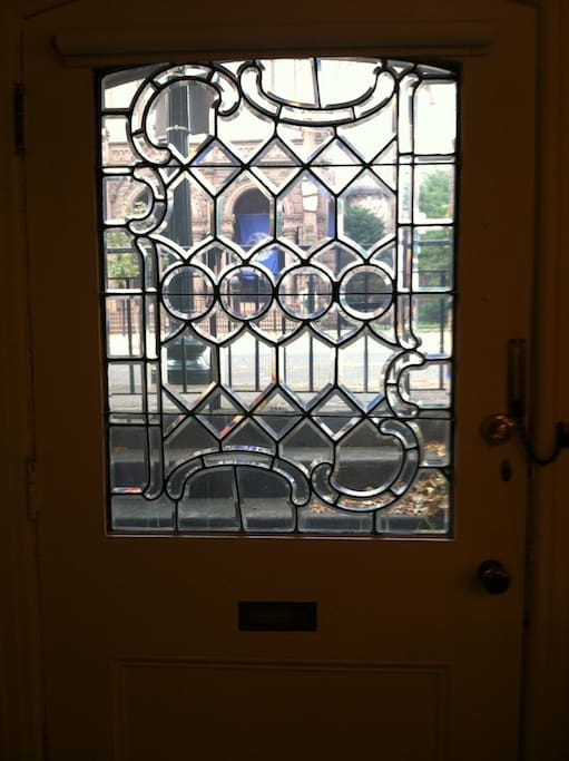 This leaded glass door creates a gracious and secure private entry from Historic 5th Avenue.