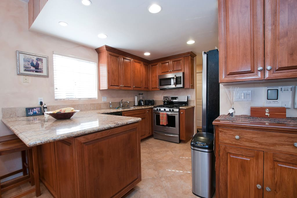 Remodeled kitchen with updated appliances.