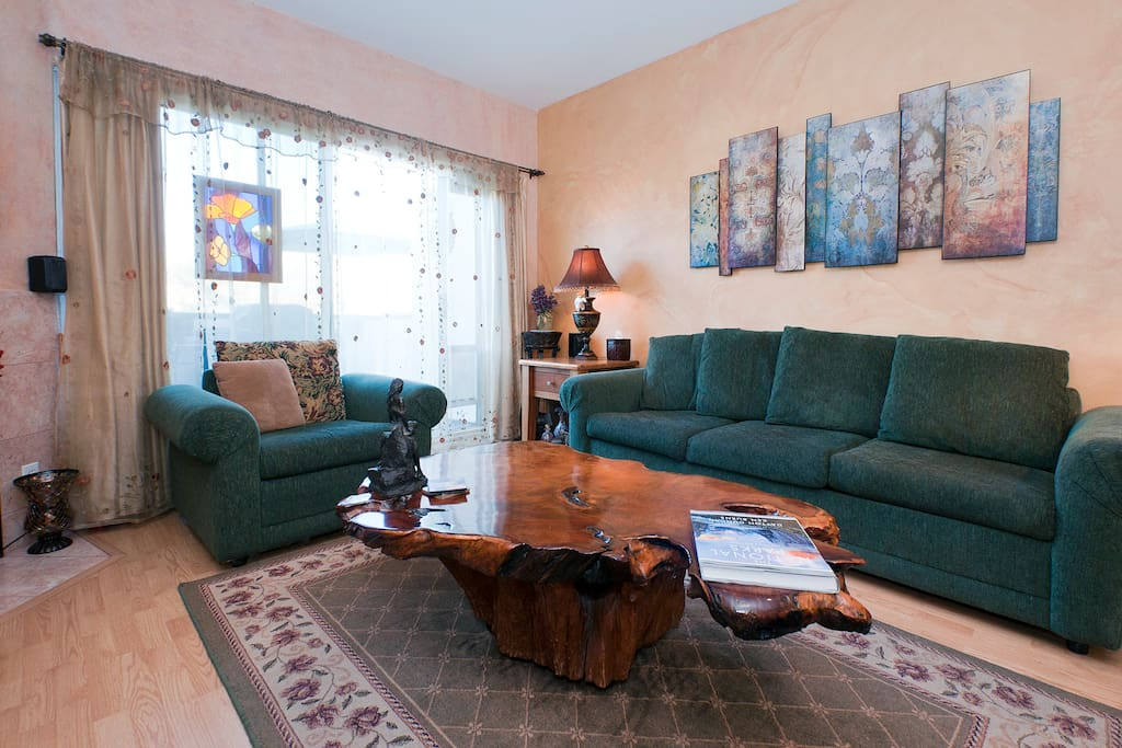 Relax in the living room. Door leads to 40' balcony with hot tub, BBQ and patio table.