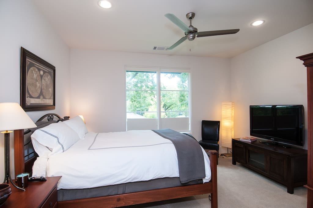 Your room with queen-sized bed featuring impeccably soft cotton down-feather duvet bedding. 46-inch HDTV with 300+ cable channels.