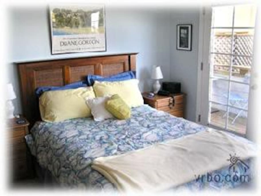 Master bedroom with door to lower balcony deck, can you hear the surf? It will lull you to sleep.