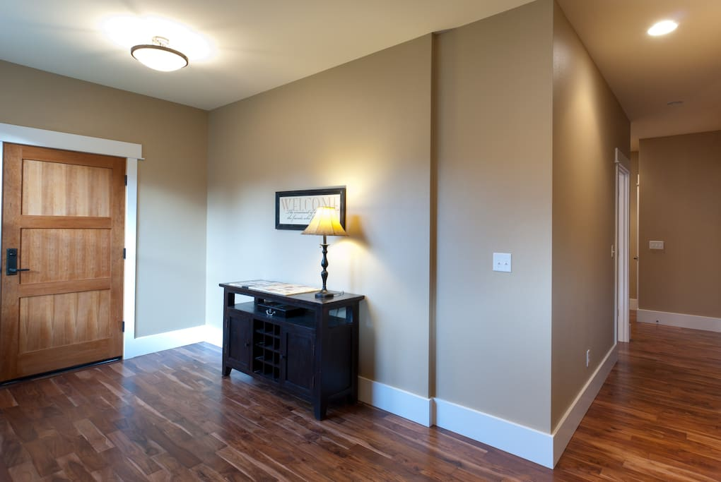 Private entry with Asian walnut floors. 1 bedroom, bathroom, utility room & elevator complete this level.