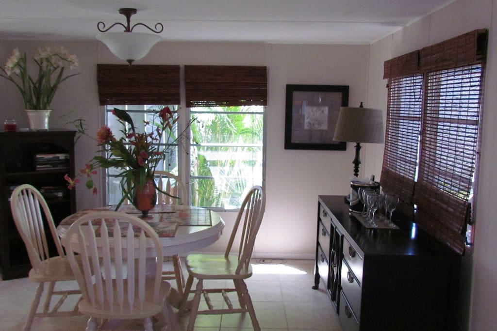 Dining Room with Table Chairs-Buffet and Wine Glasses