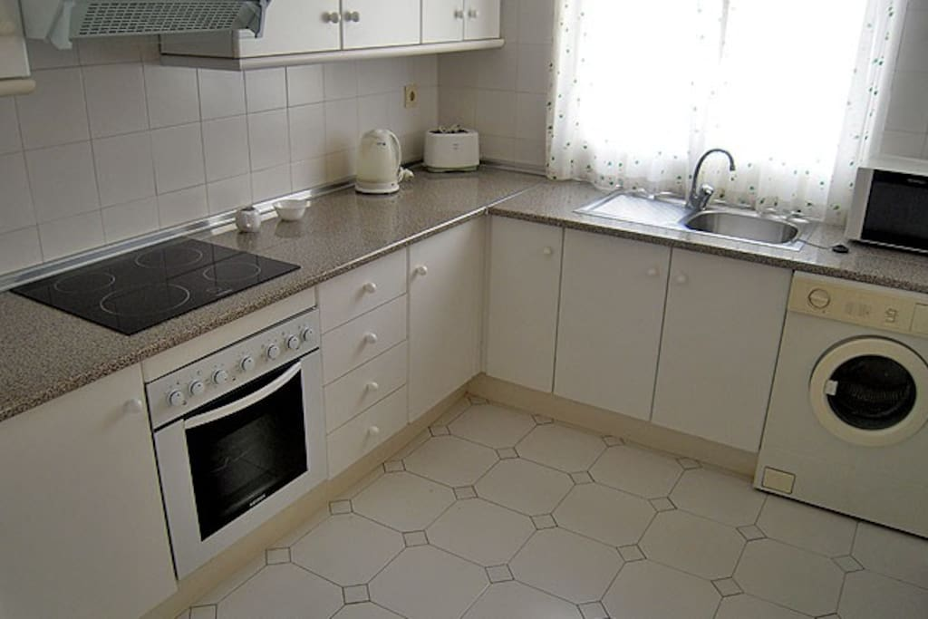 Fully equipped kitchen with oven, hob, washing machine, microwave, fridge, toaster, coffee maker and kettle, plus all the cutlery, crockery and cooking utensils you'll need.